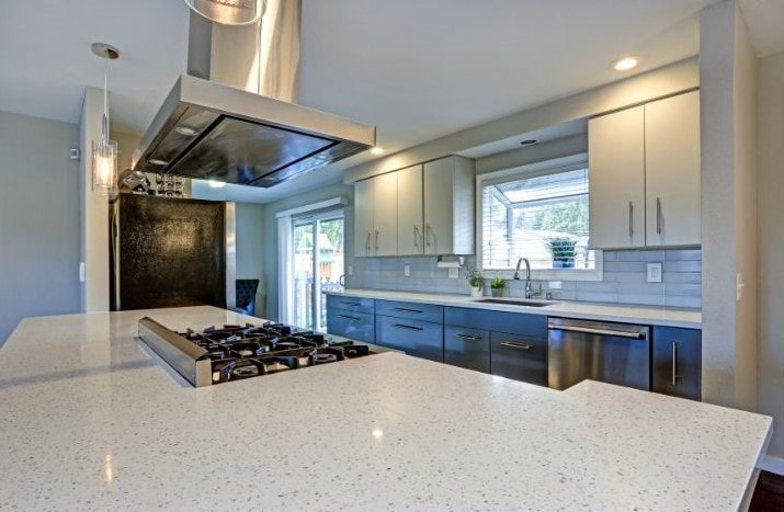 Picture of a remodeled kitchen with new countertops and kitchen appliances.